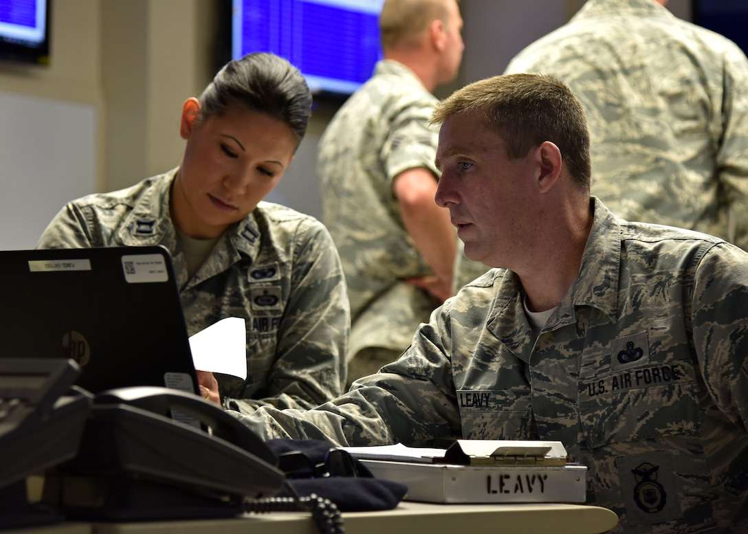 (From left) Air Force Capt. Elisa P. Shutler, 175th Security Forces Squadron deputy commander, and Air Force Chief Master Sgt. Kevin P. Leavy, 175th SFS manager, work on taking full accountability of base Airmen June 22, 2017, in the emergency operations center at Warfield Air National Guard Base, Middle River, Md. They were participating in an active shooter training exercise held on base. (U.S. Air National Guard photo by Airman Sarah M. McClanahan)