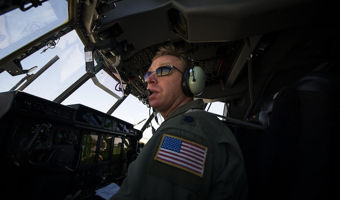 Lt. Col. Richard Hollinger, former 9th Special Operations Squadron assistant director of operations, pilots his aircraft during his 'fini flight' at Cannon Air Force Base, New Mexico, Jun. 9, 2017. Dating back to World War II, the U.S. military has celebrated pilots' and other experienced officers' final flights either at their current unit or their career. Pilots use these celebrations as another opportunity to help train accompanying Airmen on their roles aboard the aircraft to ensure mission readiness. (U.S. Air Force photo by Senior Airman Lane T. Plummer)
