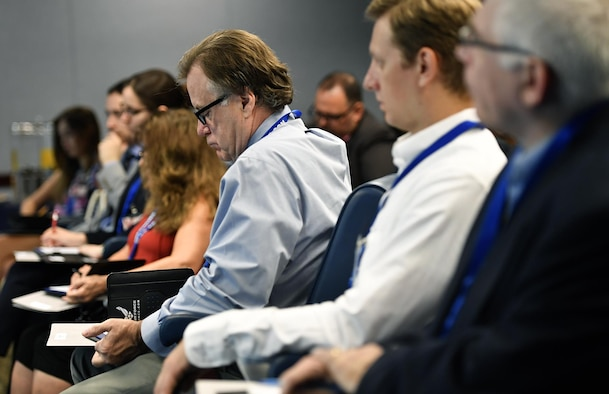 Writers from various publications listen to briefers and take notes during the Air Force's third annual Magazine Day at the Pentagon in Washington, D.C., June 21, 2017. (U.S. Air Force photo/Wayne A. Clark)