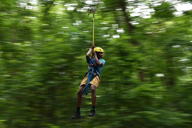 Jaheim Moseby, a Gold Star member, rides a zip line June 15, 2017, at the Hearts of Our Heroes Camp in Little Rock, Ark. The objective of the camp was to honor Arkansas's fallen service members and support their families. (U.S. Air Force photo by Airman 1st Class Kevin Sommer Giron)