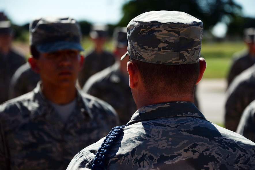 Staff Sgt. Timothy Clutter, 364th Training Squadron military training leader, looks over Airmen during an open ranks inspection. Open ranks inspections are used to ensure that Air Force Instruction 36-2903 is being properly adhered to. (U.S. Air Force photo by Senior Airman Robert L. McIlrath)