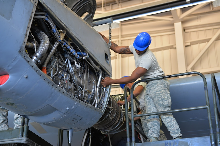 Airman Aaron Mack, 361st Training Squadron student secures the power package to the T-56 engine at Sheppard Air Force Base, Texas. This is a quick engine change stand assembly. (U.S. Air Force photo by Liz H. Colunga/Released)