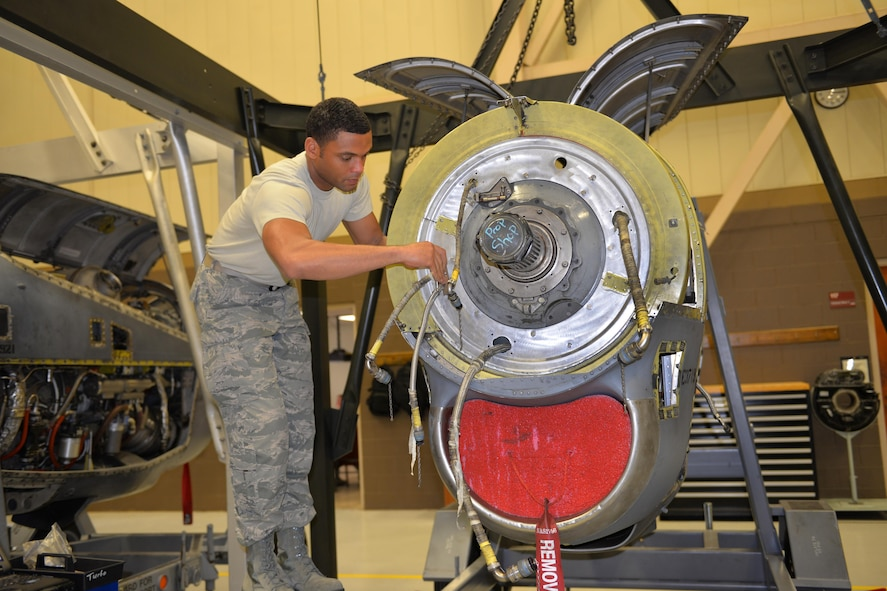 Staff Sgt. Kevin Philitas, 361st Training Squadron Aerospace and Propulsion course student adjusts the torque meter and the anti-icing shroud on a T-56 engine at Sheppard Air Force Base, Texas. (U.S. Air Force photo by Liz H. Colunga/Released)
