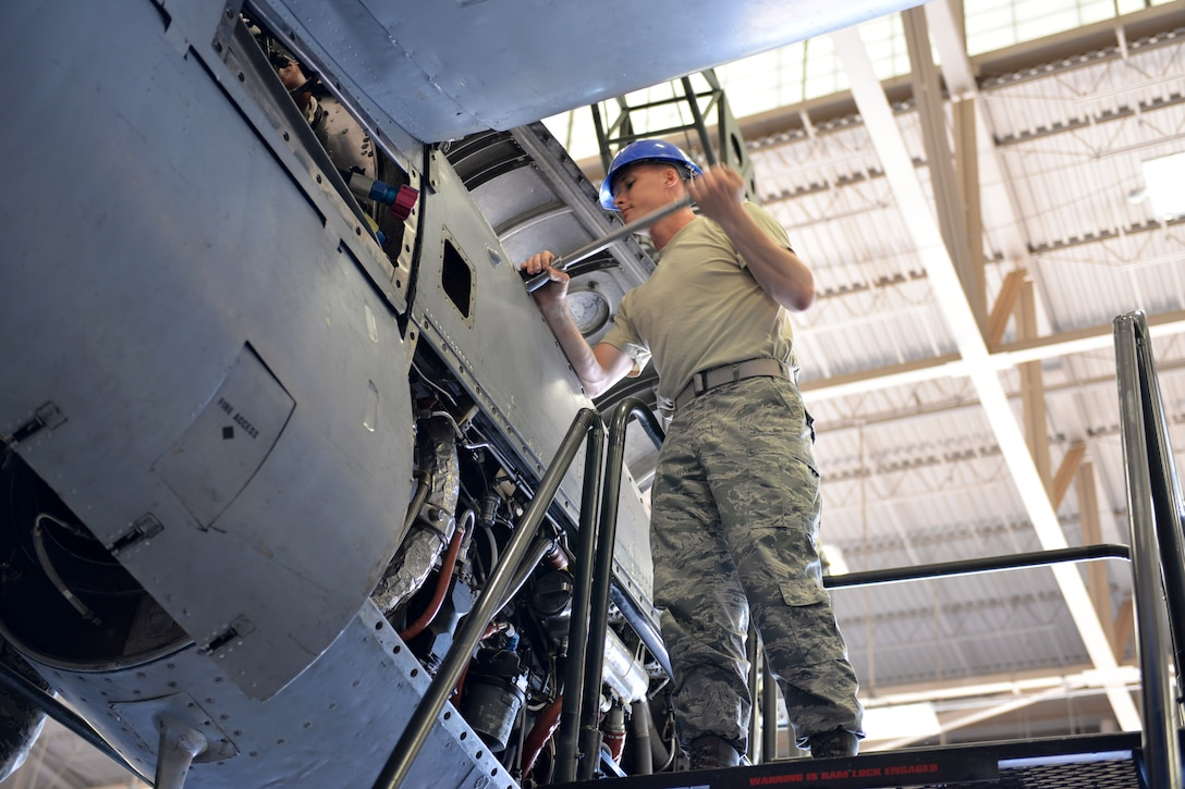 Airman Douglas Price, 361st Training Squadron student removes the power package to the T-56 engine at Sheppard Air Force Base, Texas. This is a quick engine change stand assembly. (U.S. Air Force photo by Liz H. Colunga/Released)