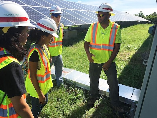 William J. Eggleston III, right, a safety engineer with the U.S. Army Engineering and Support Center, Huntsville's Safety Office, explains a solar array project at Fort Campbell, Kentucky, to summer hire, Lorraine Rosello Del Valle; Erika Cosper, a Pathways Intern; and Jacob Morrison, a summer hire during a recent trip to Fort Campbell. Work on the solar array began in 2012 when the Fort Campbell Directorate of Public Works partnered with the Huntsville Center and the Department of Energy to put together a renewable energy plan for the post.