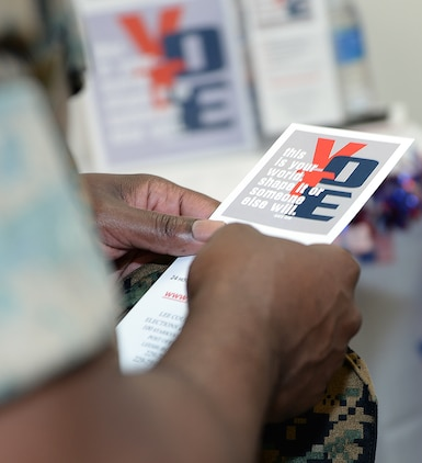 A Marine reads voting literature during the Marine Corps Logistics Base Albany's first voting convention, June 22.