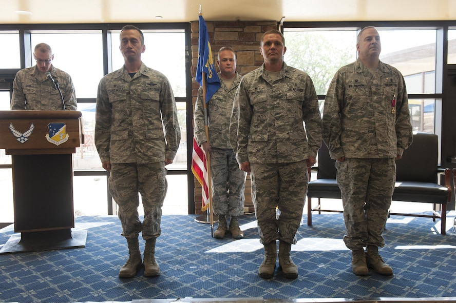Col. Paul A. Willingham, 49th Medical Group outgoing commander, (right) relinquishes command of the 49th MDG to Col. Paul R. Brezinski (center) by the authority of Col. Houston R. Cantwell, 49th Wing commander (left) at Club Holloman, June 23, 2017. The change of command ceremony is rooted in military tradition and symbolizes the passing of command so all may witness the changing of leadership responsibilities. (U.S. Air Force photo by Airman 1st Class Ilyana A. Escalona)