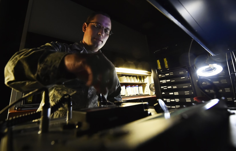 Staff Sgt. Brian Spears, 437th Operation Support Squadron aircrew flight equipment NCO in charge of night vision goggle combat survival evader locaters, inspects the integrity of an NVG at Joint Base Charleston, S.C., June 20. Airmen assigned to the 437th OSS AFE flight ensure that aircrew equipment including helmets, oxygen masks, life rafts, and parachutes are safe and ready to operate.