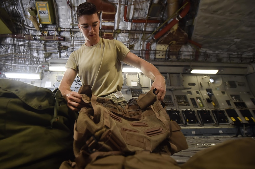 Airman 1st Class Travis Neal, 437th Operations Support Squadron aircrew flight equipment apprentice, packs survival vests and oxygen masks on board a C-17 Globemaster III as part of an inspection at Joint Base Charleston, S.C., June 22. Airmen assigned to the 437th OSS AFE flight ensure that aircrew equipment including helmets, oxygen masks, life rafts, and parachutes are safe and ready for aircrew members to operate. (U.S. Air Force photo by Staff Sgt. Christopher Hubenthal)