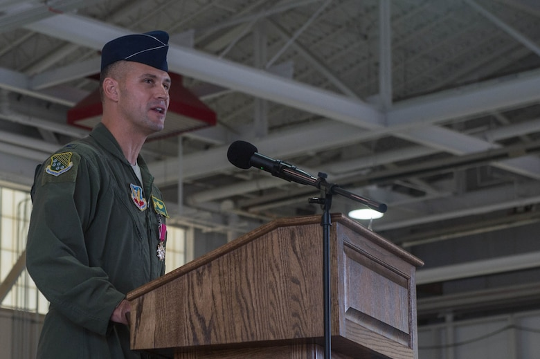 U.S. Air Force Col. Peter Fesler, former 1st Fighter Wing commander, says his final remarks to the 1st FW Airmen before relinquishing command to U.S. Air Force Col. Jason Hinds. The 1st FW has a 100 year heritage that stretches back to World War I. (U.S. Air Force photo by Senior Airman Derek Seifert)