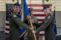 U.S. Air Force Col. Jason Hinds (right), 1st Fighter Wing commander, assumes command of the 1st FW during a change of command ceremony at Joint Base Langley-Eustis, Va., June 23, 2017. Hinds is a command pilot with more than 2,100 flying hours earned primarily in the F-22 Raptor and F-15C Eagle aircraft. (U.S. Air Force photo by Senior Airman Derek Seifert)