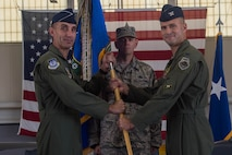 U.S. Air Force Col. Peter Fesler (right), former 1st Fighter Wing commander, relinquishes command of the 1st FW during a change of command ceremony at Joint Base Langley-Eustis, Va., June 23, 2017. The 1st FW is comprised of six squadrons of more than 1,300 members who employ and sustain worldwide rapid deployment of more than 40 F-22 Raptor aircraft. (U.S. Air Force photo by Senior Airman Derek Seifert)