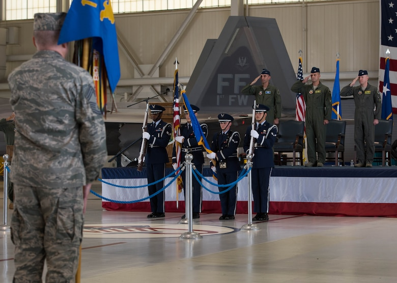 Langley Air Force Base Honor Guard members present the colors during the 1st Fighter Wing change of command ceremony at Joint Base Langley-Eustis, Va., June 23, 2017. U.S. Air Force Col. Peter Fesler relinquished command to U.S. Air Force Col. Jason Hinds after two years of service. (U.S. Air Force photo/Staff Sgt. J.D. Strong II)