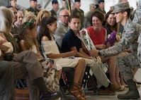 Addison Fesler, daughter of U.S. Air Force Col. Peter Fesler, 1st Fighter Wing outgoing commander, receives a gift during the 1st FW change of command ceremony at Joint Base Langley-Eustis, Va., June 23, 2017. Fesler will continue his career at Peterson Air Force Base in Colorado Springs, Colo., at North American Aerospace Defense Command as the vice director of operations. (U.S. Air Force photo/Staff Sgt. J.D. Strong II)