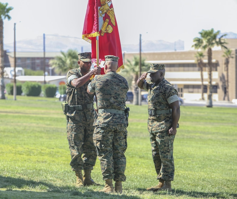 Lt. Col. Philip C. Laing, outgoing commanding officer, 3rd Light Armored Reconnaissance Battalion, relinquished command to Lt. Col. Rafael A. Candelario II, oncoming commanding officer, 3rd LAR, by handing of the battalion colors during the 3rd LAR change of command ceremony at Lance Cpl. Torrey L. Gray Field aboard Marine Corps Air Ground Combat Center Calif., June 15.