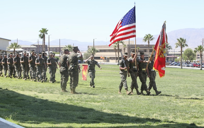 The 3rd Light Armored Reconnaissance Battalion Color Guard presents the colors during the 3rd LAR change of command ceremony at Lance Cpl. Torrey L. Gray Field aboard Marine Corps Air Ground Combat Center Calif., June 15. During the ceremony, Lt. Col. Philip C. Laing, outgoing commanding officer, 3rd LAR, relinquished command to Lt. Col. Rafael A. Candelario II, oncoming commanding officer, 3rd LAR.