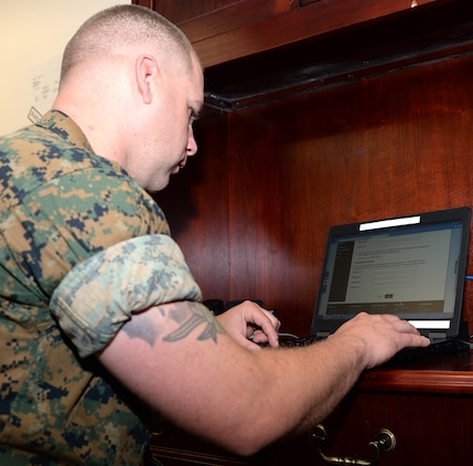 Gunnery Sgt. Tyler Nichols, ordnance officer, Logistics Support Division, Marine Corps Logistics Base Albany, registers to vote during the installation's first voting convention, June 22.