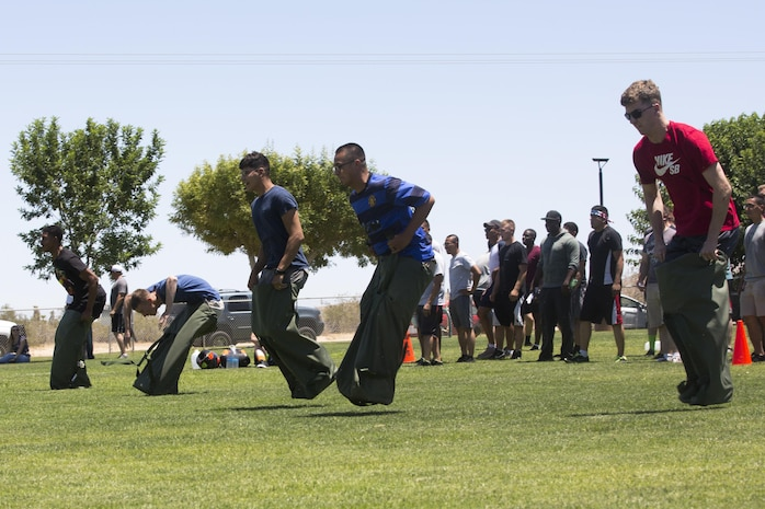 Marines of 1st Tank Battalion participate in a sack race during the battalion's Family Day held at Luckie Park, Twentynine Palms, Calif., June 14, 2017. The battalion held the family day to promote camaraderie and bring the battalion's families closer together.