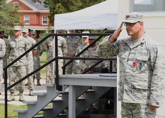 Colonel Stephen Kravitsky, 90th Missile Wing commander, returns the final salute given to him by his troops at the change of command ceremony on the Argonne Parade Field at F.E. Warren Air Force Base, Wyo., June 23, 2017. (U.S. Air Force photo by Glenn S. Robertson)
