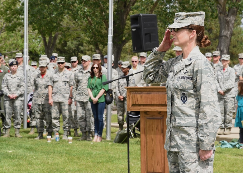 Colonel Stacy Huser, 90th Missile Wing commander, returns the first salute given to her by her wing at the change of command ceremony on the Argonne Parade Field at F.E. Warren Air Force Base, Wyo., June 23, 2017. The ceremony signified the transition of command from Col. Stephen Kravitsky to Huser. (U.S. Air Force photo by Glenn S. Robertson)