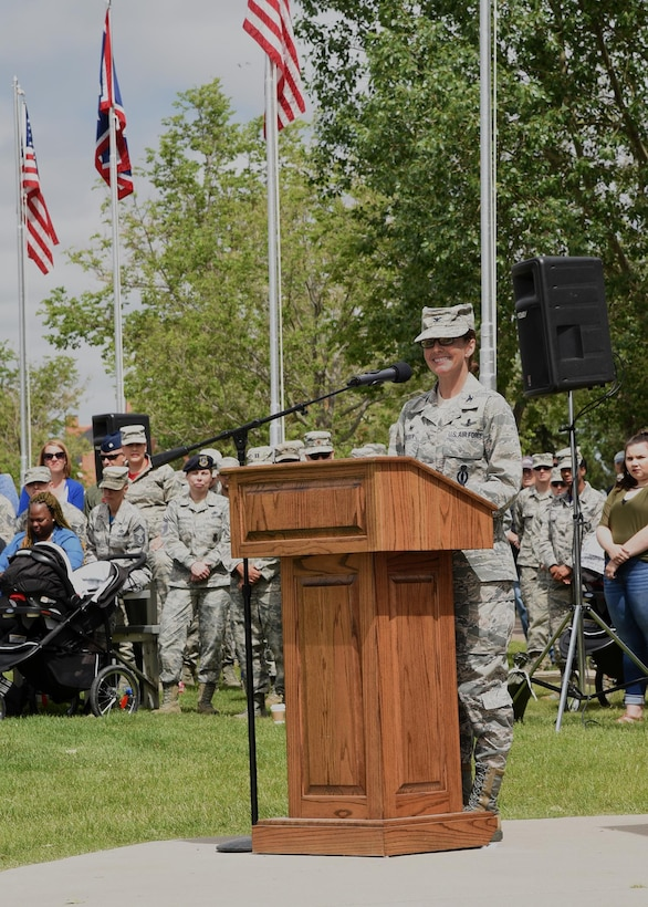 Colonel Stacy Huser, 90th Missile Wing commander, speaks to the crowd attending the 90th Missile Wing Change of Command on the Argonne Parade Field at F.E. Warren Air Force Base, Wyo., June 23, 2017. She took time to thank the supporters, mentors and leaders who helped her along the way. (U.S. Air Force photo by Glenn S. Robertson)