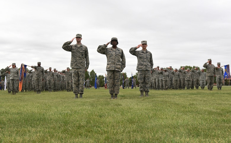 Airmen with the 90th Medical Group and the 90th Operations Group render a salute on the parade field during a change of command ceremony at F.E. Warren Air Force Base, Wyo., June 23, 2017. Col. Stacy Huser assumed command of the 90th Missile Wing during the ceremony. (U.S. Air Force photo by Airman 1st Class Breanna Carter)