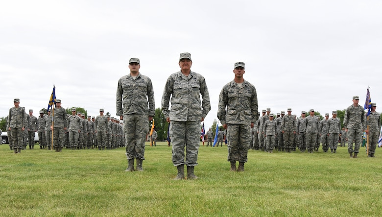 Airmen with the 90th Mission Support Group stand in formation on the parade field during the 90th Missile Wing change of command ceremony at F.E. Warren Air Force Base, Wyo., June 23, 2017. Col. Stacy Huser assumed command of the wing from Col. Stephen Kravitsky during the ceremony. (U.S. Air Force photo by Airman 1st Class Breanna Carter)