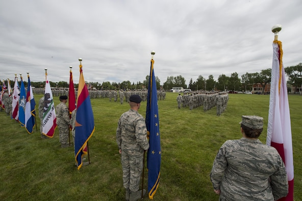 Airmen of the 90th Missile Wing stand in formation during the 90th MW change of command ceremony on the Argonne Parade Field at F.E. Warren Air Force Base, Wyo., June 23, 2017. Members from all four groups within the wing participated in the formation. The change of command ceremony signified the transition of command from Col. Stephen Kravitsky to Col. Stacy Huser. (U.S. Air Force photo by Staff Sgt. Christopher Ruano)