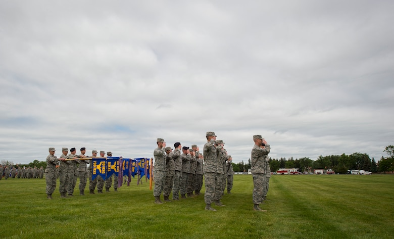 Group and squadron commanders on the parade field render a salute to Maj. Gen. Anthony Cotton, 20th Air Force commander, during the 90th Missile Wing change of command ceremony on the Argonne Parade Field at F.E. Warren Air Force Base, Wyo., June 23, 2017. Cotton was the presiding officer at the change of command ceremony. The event signified the transition of command from Col. Stephen Kravitsky to Col. Stacy Huser. (U.S. Air Force photo by Staff Sgt. Christopher Ruano)