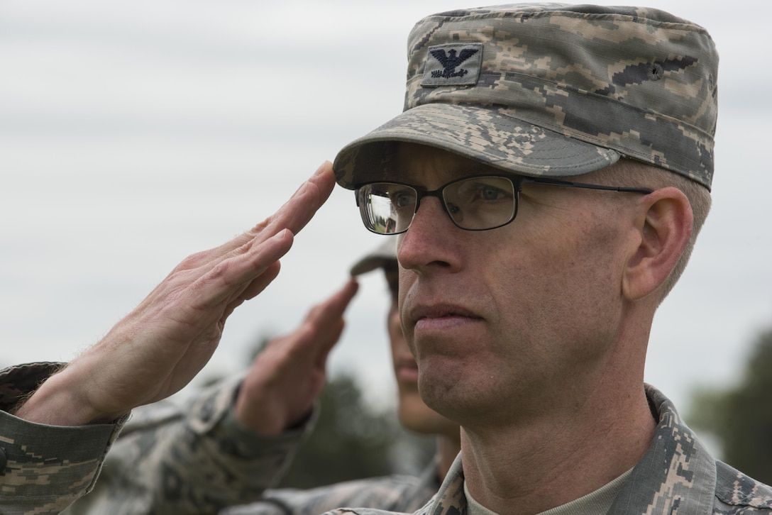 Colonel Greg Buckner, 90th Maintenance Group commander, renders a salute during the 90th Missile Wing change of command ceremony on the Argonne Parade Field at F.E. Warren Air Force Base, Wyo., June 23, 2017. The 90th MXG provides world-class maintenance for the 90th MW's 150 Minuteman III ICBM's and their launch facilities as well as 15 missile alert facilities and associated equipment. The change of command ceremony signified the transition of command from Col. Stephen Kravitsky to Col. Stacy Huser. (U.S. Air Force photo by Staff Sgt. Christopher Ruano)
