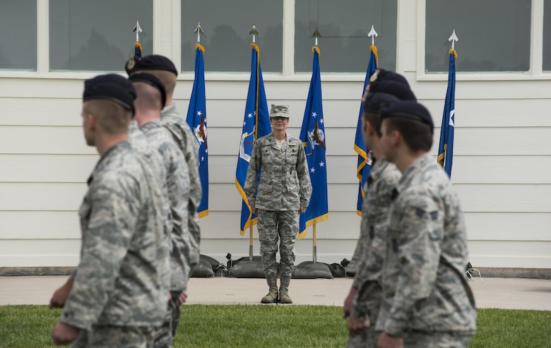 Group formations conduct a pass in review for Col. Stacy Huser, 90th Missile Wing commander, during the 90th MW change of command ceremony on the Argonne Parade Field at F.E. Warren Air Force Base, Wyo., June 23, 2017. A formal parade is a long-standing military tradition that began as a way for a newly-assigned commander to inspect their troops. The ceremony signified the transition of command from Col. Stephen Kravitsky to Huser. (U.S. Air Force photo by Staff Sgt. Christopher Ruano)