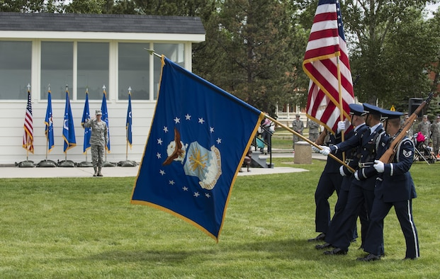 Colonel Stacy Huser, 90th Missile Wing commander, renders a salute as the F.E. Warren Air Force Base honor guard march pass during the 90th MW change of command ceremony pass in review on the Argonne Parade Field at F.E. Warren Air Force Base, Wyo., June 23, 2017. A formal parade is a long-standing military tradition that began as a way for a newly-assigned commander to inspect their troops. The change of command ceremony signified the transition of command from Col. Stephen Kravitsky to Huser. (U.S. Air Force photo by Staff Sgt. Christopher Ruano)