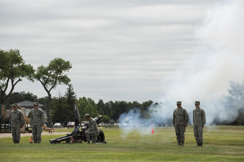 Conventional ammunition Airmen from the 90th Munitions Squadron operate a cannon during the 90th Missile Wing change of command ceremony on the Argonne Parade Field at F.E. Warren Air Force Base, Wyo., June 23, 2017. The cannon sounded as Maj. Gen. Anthony Cotton, 20th Air Force commander, passed the 90th MW guidon to the incoming commander, Col. Stacy Huser. The change of command ceremony signified the transition of command from Col. Stephen Kravitsky to Huser. (U.S. Air Force photo by Staff Sgt. Christopher Ruano)