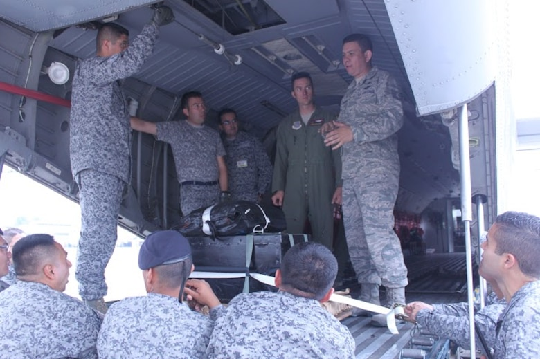Tech. Sgt. Horacio Guzman Hernandez, 571st Mobility Support Advisory Squadron, teaches Colombian service members rigging techniques. (Courtesy photo)