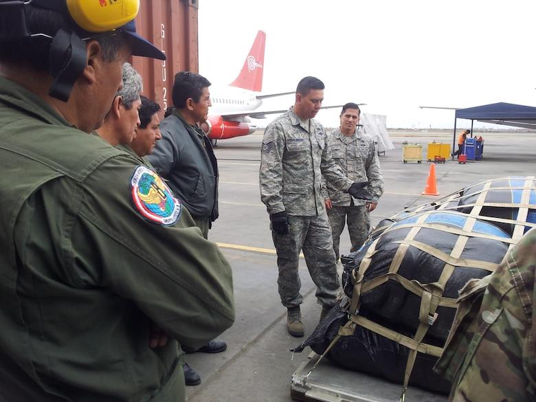 Tech. Sgt. Horacio Guzman Hernandez, 571st Mobility Support Advisory Squadron, teaches Peruvian service members pallet build-up techniques. (Courtesy photo)