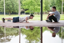 Chris Geter and Jonathan Green, 403rd Developmental and Training Flight trainees, take turns practicing pushups during a physical training session June 3, 2017 at Keesler Air Force Base, Mississippi.(U.S. Air Force photo/Staff Sgt. Heather Heiney)