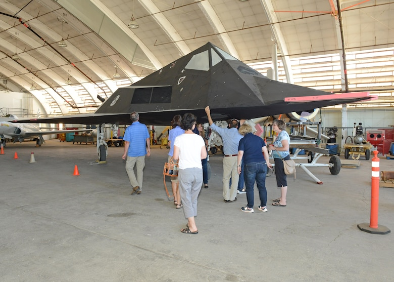 Members of Class 91B of the U.S. Air Force Test Pilot School check out an F-117 Nighthawk in the Air Force Flight Test Museum's restoration hangar during a recent reunion on Edwards Air Force Base. (U.S. Air Force photo by Kenji Thuloweit)