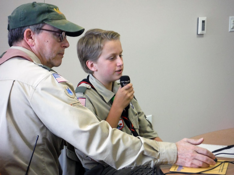 Dudley Allen, 55th Force Support Squadron management analyst, assists a boy scout with radio operations.