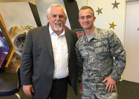 "John Ratzenberger, professional actor, takes a picture with Airman 1st Class Clayton Wear, 30th Space Wing Public Affairs photojournalist, before the ""Cars 3"" movie premiere at the base theater, June 16, 2017, Vandenberg Air Force Base, Calif. Ratzenberger voices the character, Mack, for the third time in the ""Cars"" movie series, and has voiced a character in every Pixar movie. (Courtesy photo)"