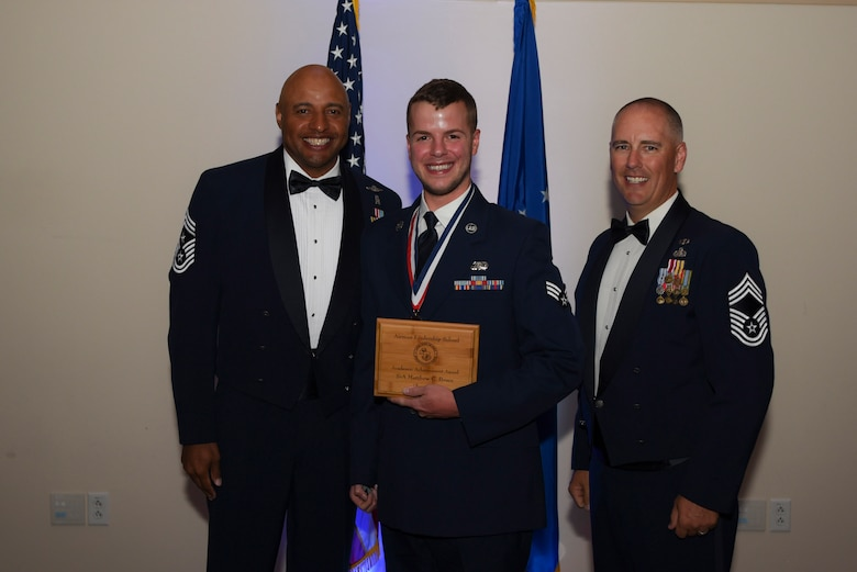 Senior Airman Matthew C. Bruce, 460th Space Communication Squadron client system technician, receives the Academic Achievement Award during Airman Leadership School Class 17E graduation June 22, 2017, on Buckley Air Force Base, Colo. This award was earned by graduating with the highest overall grade at the end of the six-week class. (U.S. Air Force photo by Airman 1st Class Holden S. Faul/ released)