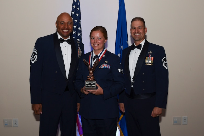 Senior Airman Meghan L. Griswold, 460th Operations Group intelligence analyst, receives the John L. Levitow Award during Airman Leadership School Class 17E graduation June 22, 2017, on Buckley Air Force Base, Colo. The John L. Levitow Award is the highest award presented at ALS, and is presented to the student who demonstrated the most outstanding leadership and scholastic qualities. (U.S. Air Force photo by Airman 1st Class Holden S. Faul/ released)