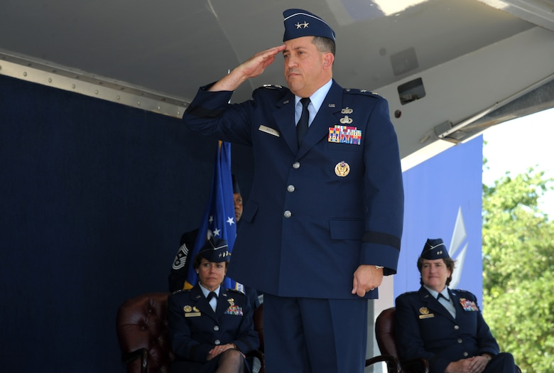 U.S. Air Force Maj. Gen. Brian Kelly, Air Force Personnel Center commander, renders his first salute to a formation representing the AFPC team during an official change of command ceremony June 23, 2017 at Joint Base San Antonio-Randolph, Texas. Kelly assumed this role as Maj. Gen. Peggy Poore formally relinquished command after several years of dedicated service. (U.S. Air Force photo by Joel Martinez)