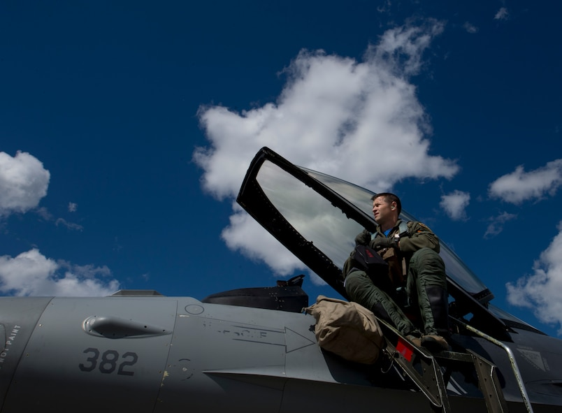 U.S. Air Force fighter pilot, Lt. Col. Ryan Ley, assigned to the 14th Fighter Squadron prepares for a flight on an F-16 during RED FLAG-Alaska 17-2 June 16, 2017, at Eielson Air Force Base, Alaska. RED FLAG-Alaska provides an optimal training environment in the Indo-Asia Pacific Region and focuses on improving ground, space, and cyberspace combat readiness and interoperability for U.S. and international forces.  (U.S. Air Force photo by Airman 1st Class Haley D. Phillips)