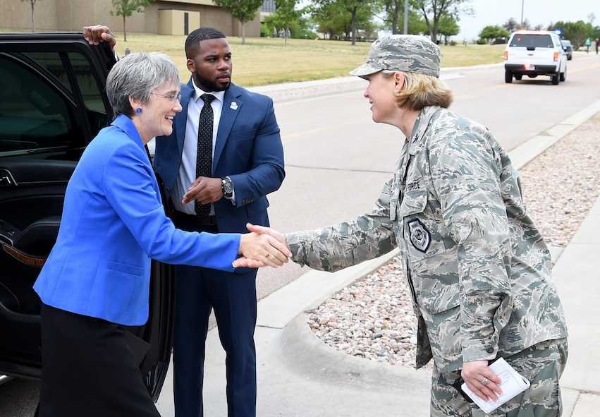 Secretary of the Air Force, Dr. Heather Wilson, shakes hands with Col. DeAnna Burt, 50th Space Wing commander during her visit to Schriever Air Force Base, Colorado, Friday, June 23, 2017. The visit marked the second time the Air Force's top ranking official has visited Schriever since her appointment as secretary in May. Wilson accompanied Vice President Mike Pence during the visit, marking the first time a vice president has visited Schriever. (U.S. Air Force photo/Staff Sgt. Wes Wright)