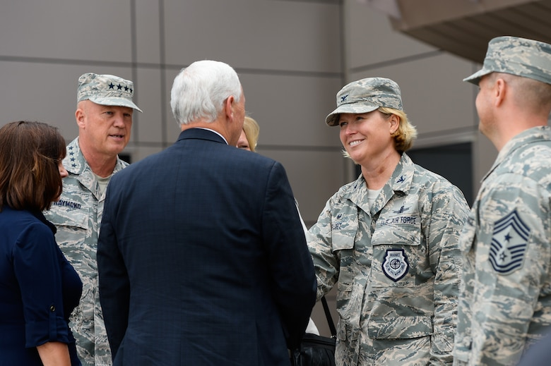 Vice President Mike Pence shakes hands with Col. Deanna Burt, 50th Space Wing commander while Gen. John Raymond, Air Force Space Command commander, looks on during his visit to the 50th Space Wing visit at Schriever Air Force Base, Colo., Friday, June 22, 2017. Pence also visited with airmen during a luncheon and witnessed 2nd Space Operation's Global Positioning System command and control functions. (U.S. Air Force photo/Christopher DeWitt)