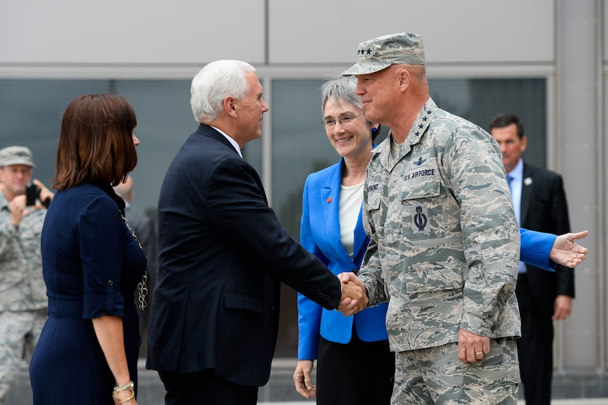 Vice President Mike Pence shakes hands with Gen. John Raymond, Air Force Space Command commander, while Secretary of the Air Force Heather Wilson looks on during his visit to the 50th Space Wing visit at Schriever Air Force Base, Colo., Friday, June 22, 2017. Vice President Pence was given an orientation on space operations following the current administration's re-establishment of the National Space Council.     (U.S. Air Force photo/Christopher DeWitt)