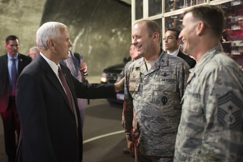CHEYENNE MOUNTAIN AIR FORCE STATION, Colo. - Vice President Mike Pence speaks with Col. Doug Schiess, 21st Space Wing commander, and Chief Master Sgt. Mark Bronson, 21st SW command chief, during his visit to Cheyenne Mountain Air Force Station, Colo., June 23, 2017.  It has been 34 years since the last visit by the vice president of the United States. (U.S. Air Force photo by Senior Airman Dennis Hoffman)