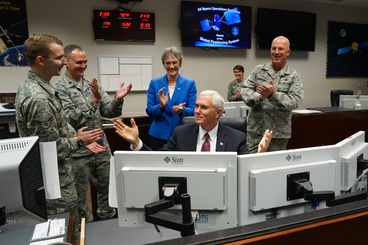 Vice President Mike Pence, sends a payload command to a Global Positioning System satellite at Schriever Air Force Base, Colo., Friday, June 22, 2017.  The command is part of the care and feeding 50th Space Wing space professionals provide on a daily basis to ensure Global Positioning System satellites remain the world's premiere space-based position, navigation and timing system. The Vice President was on base for a space orientation in support of the administration's relaunch of the National Space Council. (U.S. Air Force photo/Christopher DeWitt)