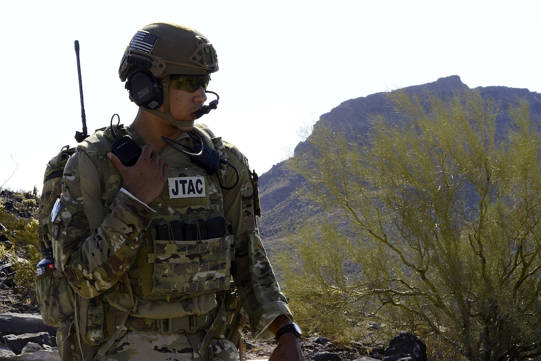 Airman 1st Class Anthony Butler, 10th Air Support Operations Squadron joint terminal attack controller, speaks to aircrew during training, June 22, 2017, at Barry M. Goldwater Range, Ariz. Communication between pilots and JTACs is verified between both parties, ensuring the correct target is identified and struck. (U.S. Air force photo/Staff Sgt. Trevor Rhynes)