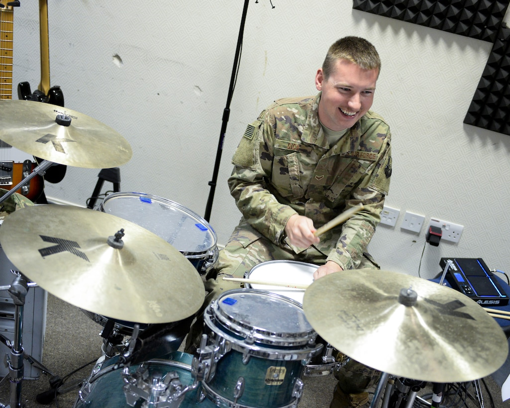 U.S. Air Force Airman 1st Class Joshua Dick, drummer assigned to the Air Force Central Command Band, practices drums in preparation for a concert at Al Udeid, Air Force Base, Qatar, May 25, 2017. The AFCENT Band, stationed at Al Udeid, travels throughout the Central Command Area of Responsibility in support of building partnerships, boosting morale, and providing diplomacy and outreach to host nation communities. (U.S. Air Force photo by Tech. Sgt. Bradly A. Schneider/Released)